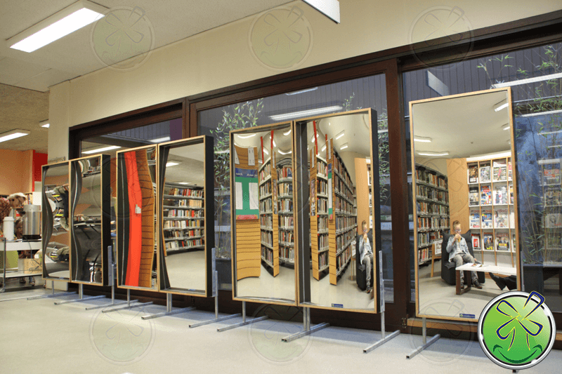 Rental set of laughing mirrors in library in Grimbergen Belgium.