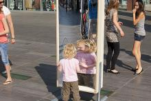 In front of the plaza in Eindhoven a laughing mirror from distortingmirrors.co.uk