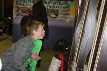 Children in front of laughing mirrors